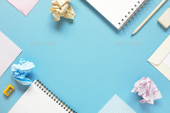 Blue Background with Notepads and Crumpled  Sheets of Paper - Stock Photo - Images