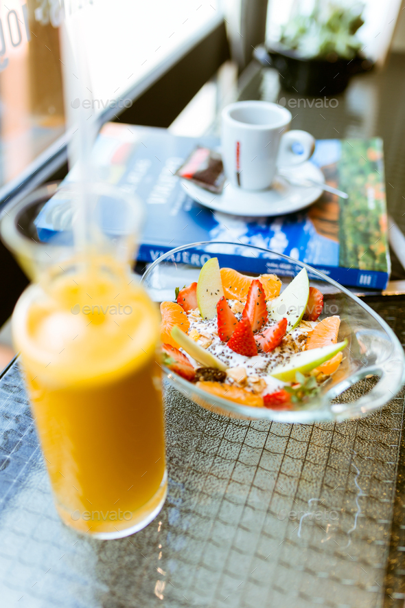 Healthy yogurt with fruits and orange juice in a restaurant. - Stock Photo - Images