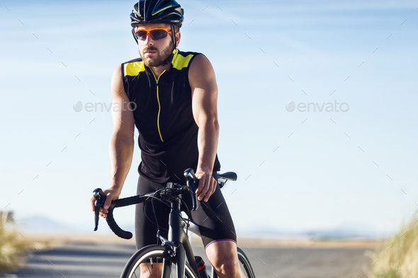 Handsome young man taking a break after a cycling training sessi - Stock Photo - Images