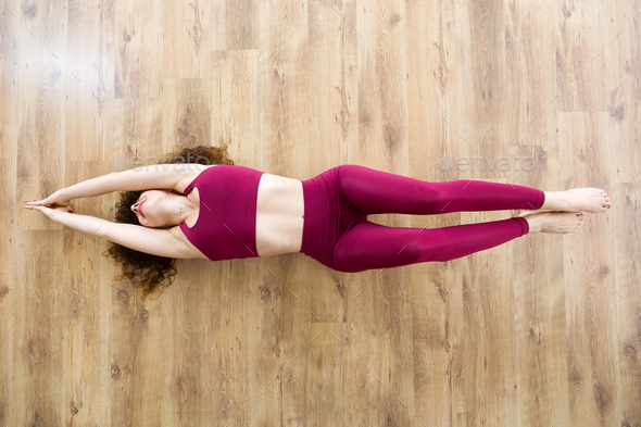 Pretty young woman practicing yoga at home. - Stock Photo - Images