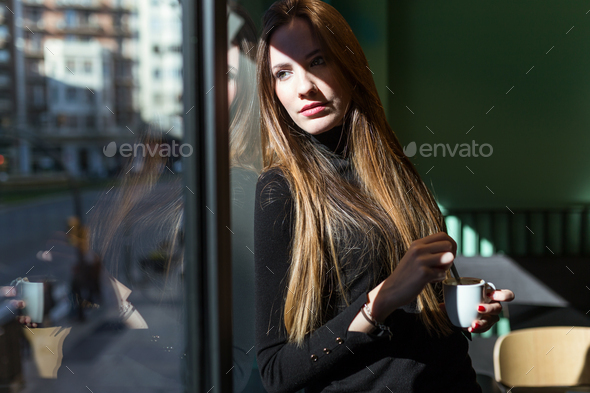 Beautiful young woman posing in the coffee. - Stock Photo - Images