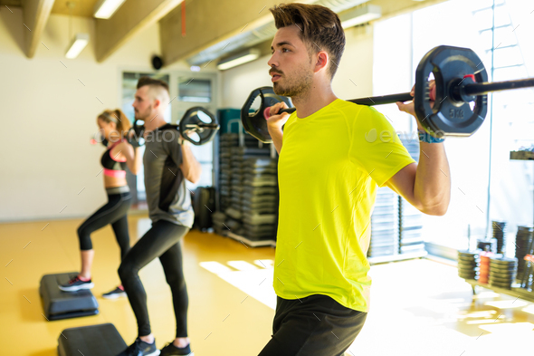 Group of sporty people doing aerobic class on a fitness center. - Stock Photo - Images
