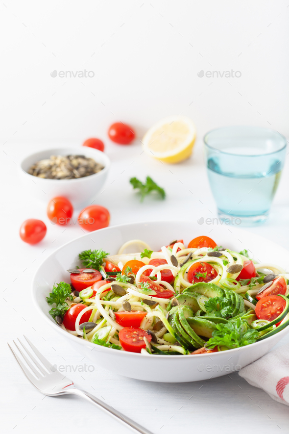 vegan ketogenic spiralized courgette salad with avocado tomato p - Stock Photo - Images