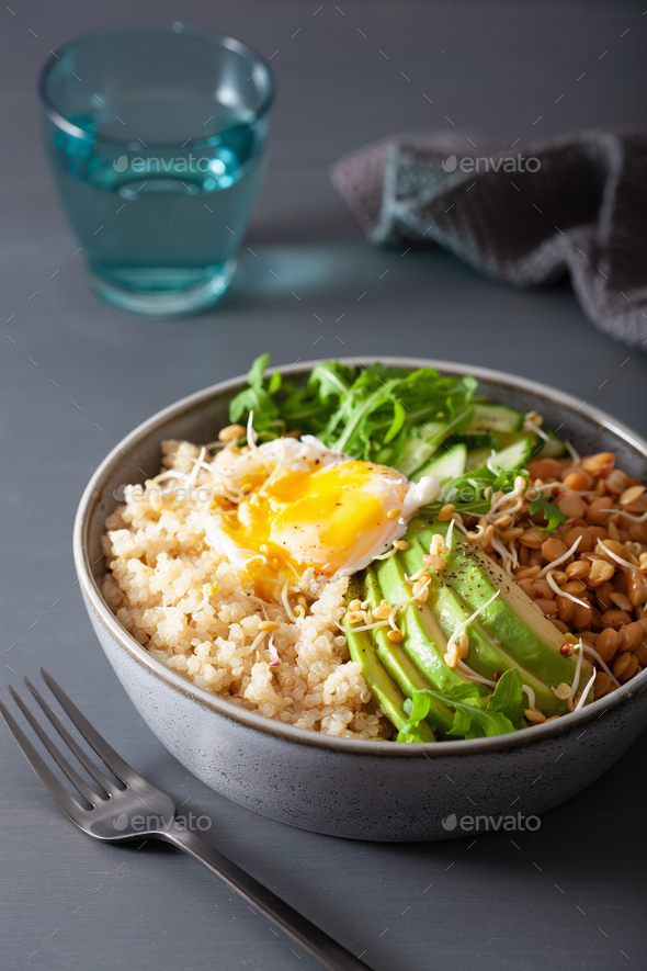quinoa bowl with egg, avocado, cucumber, lentil. Healthy vegetar - Stock Photo - Images