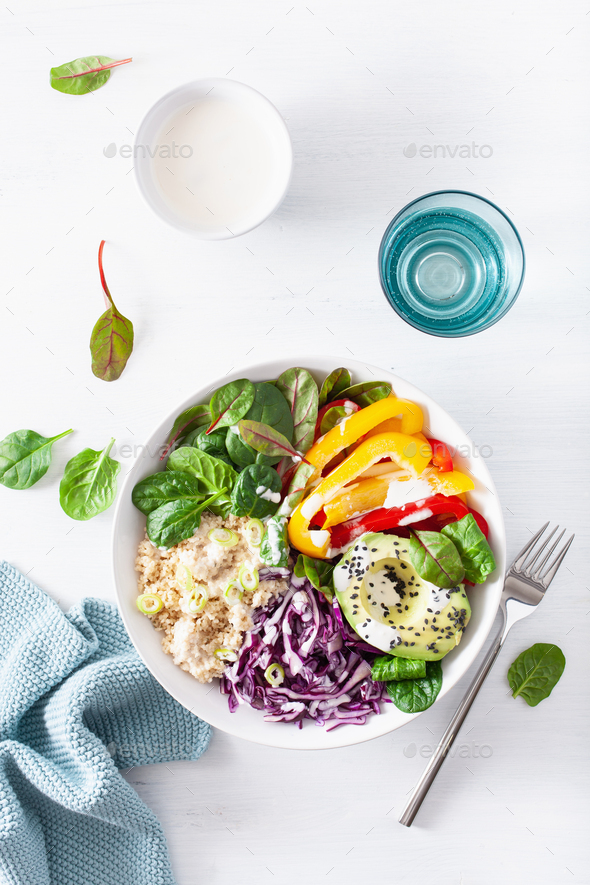 veggie couscous lunch bowl with avocado, bell peppers, spinach a - Stock Photo - Images