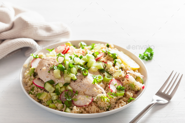 chicken breast with couscous, cucumber, avocado, spring onion, r - Stock Photo - Images