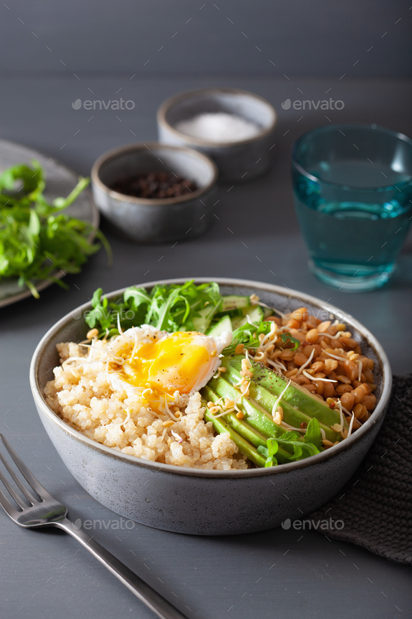 quinoa bowl with egg, avocado, cucumber, lentil. Healthy vegetar - Stock Photo - Images