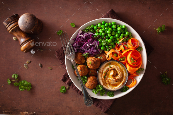 healthy vegan lunch bowl with falafel hummus carrot ribbons cabb - Stock Photo - Images