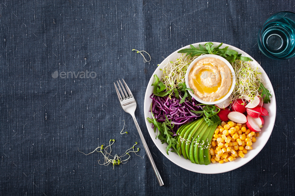 vegan avocado sweet corn lunch bowl with hummus, red cabbage, ra - Stock Photo - Images