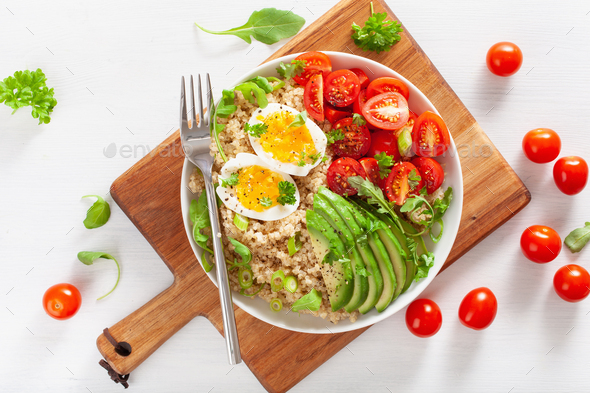 quinoa with boiled egg, avocado, tomato, arugula. healthy breakf - Stock Photo - Images