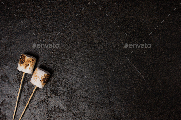 Black Textured Background with Grilled Marshmallow - Stock Photo - Images