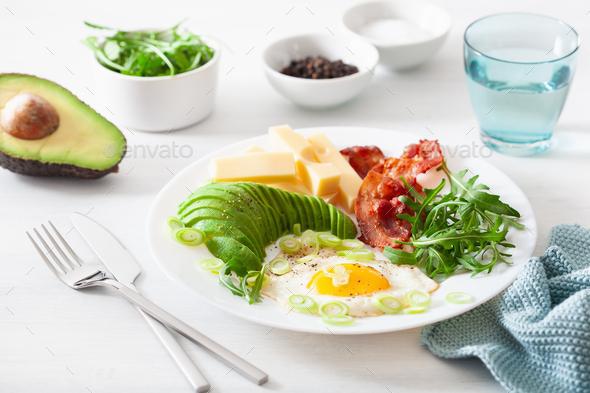 healthy keto breakfast: egg, avocado, cheese, bacon - Stock Photo - Images