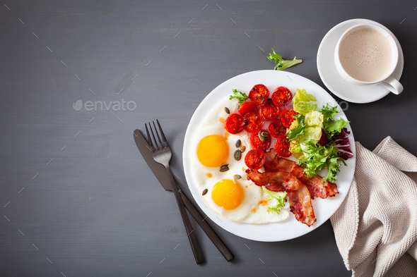 healthy keto diet breakfast: egg, tomatoes, salad leaves and bac - Stock Photo - Images