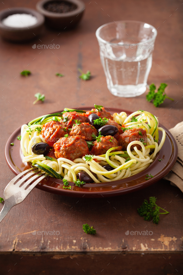 keto paleo zoodles zucchini noodles with meatballs and olives - Stock Photo - Images