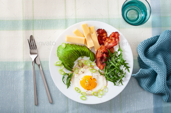 healthy keto breakfast: egg, avocado, cheese, bacon - Stock Photo - Images