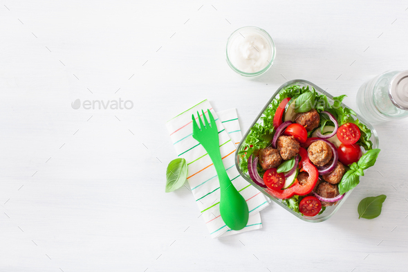 keto paleo lunch box with meatballs, lettuce, tomato, cucumber, - Stock Photo - Images