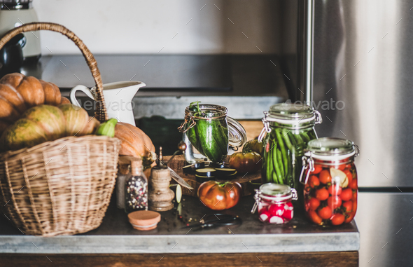 Fresh ingredients and glass jars with homemade vegetables preserves, close-up - Stock Photo - Images