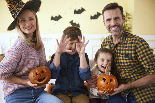 Portrait of family and halloween pumpkins - Stock Photo - Images