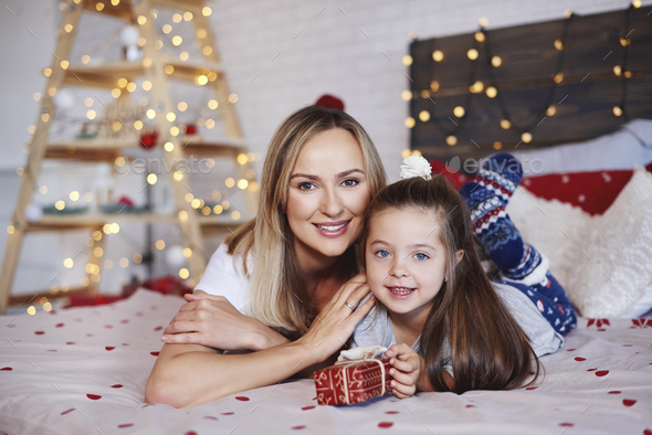 Portrait of mother and daughter with christmas present - Stock Photo - Images