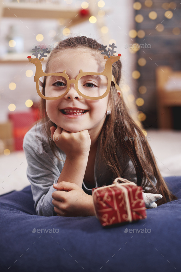 Portrait of happy girl with christmas present - Stock Photo - Images