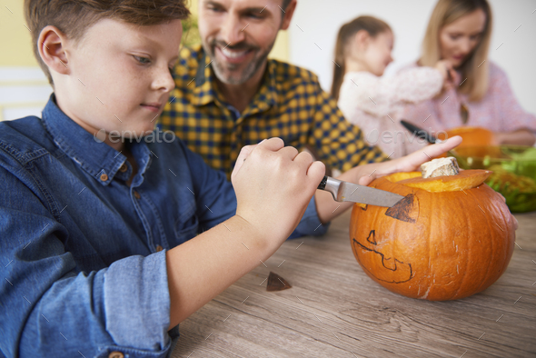 Boy making decorations for Halloween - Stock Photo - Images