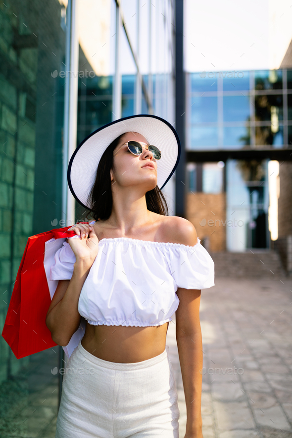 Beautiful young woman shopping and traveling on summer - Stock Photo - Images