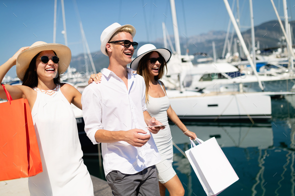Happy tourist friends having fun on summer travel vacation - Stock Photo - Images