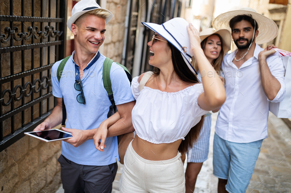 Happy group of friends enjoying traveling and vacation - Stock Photo - Images