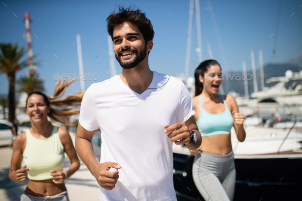 Friends running fitness training together outdoors living active healthy - Stock Photo - Images
