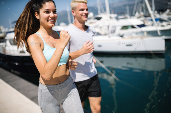 Exercising runners people training outdoors living healthy active lifestyle - Stock Photo - Images