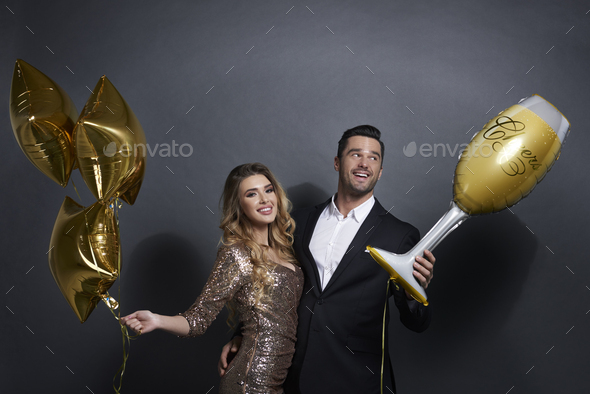 Happy couple with balloons celebrating at studio shot - Stock Photo - Images