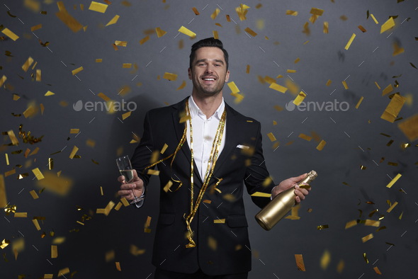 Portrait of smiling man drinking alcohol at studio shot - Stock Photo - Images