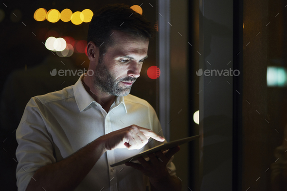 Businessman using a tablet in his office - Stock Photo - Images