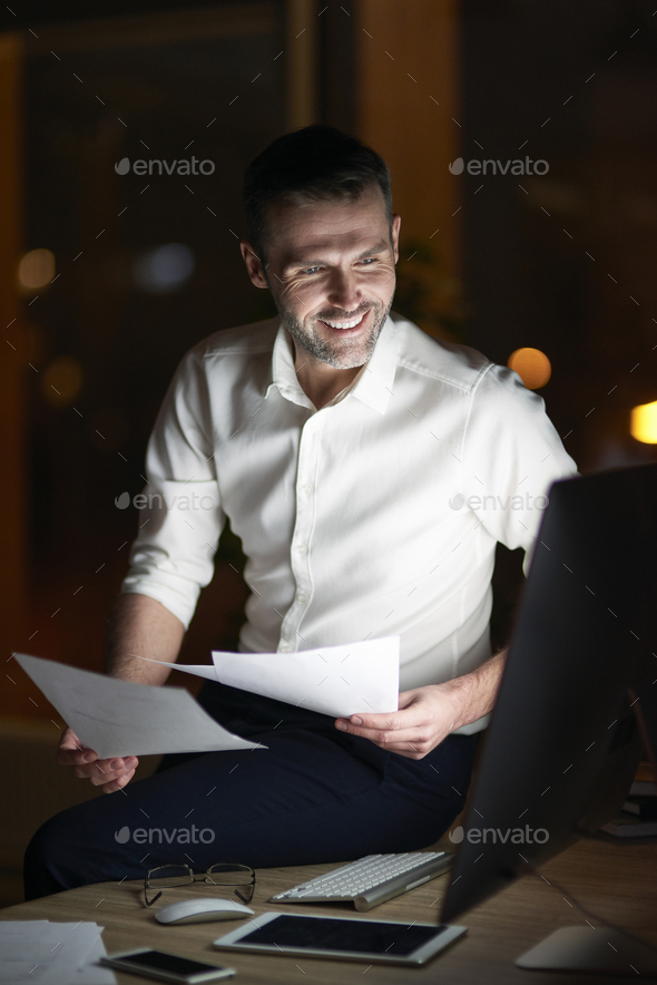 Man analyzing document at night - Stock Photo - Images