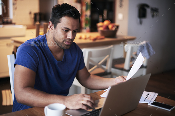 Man using a laptop at home - Stock Photo - Images