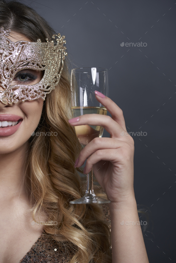 Part of woman with mask making a toast - Stock Photo - Images