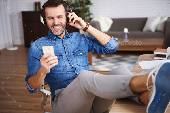 Mature men listening to music and resting - Stock Photo - Images