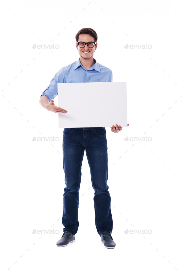 Man wearing glasses holding white board - Stock Photo - Images