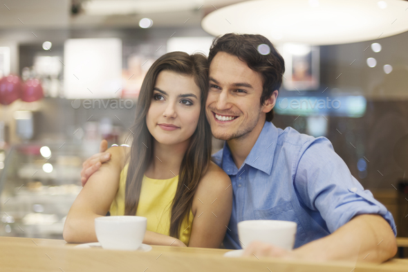 Portrait of couple on romantic date in cafe - Stock Photo - Images