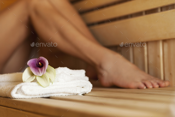 Close up of fresh towels and flowers in sauna - Stock Photo - Images
