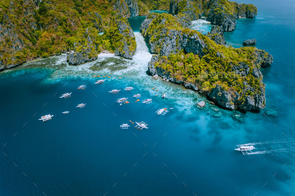 Aerial view of amazing Mililoc Island. Tourist boats near big Lagoon. El Nido, Palawan, Philippines - Stock Photo - Images