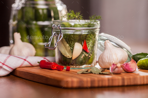 Preparing sour cucumbers in the kitchen - Stock Photo - Images