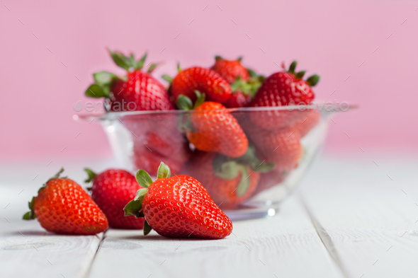 Fresh ripe strawberry in glass bowl on wood - Stock Photo - Images