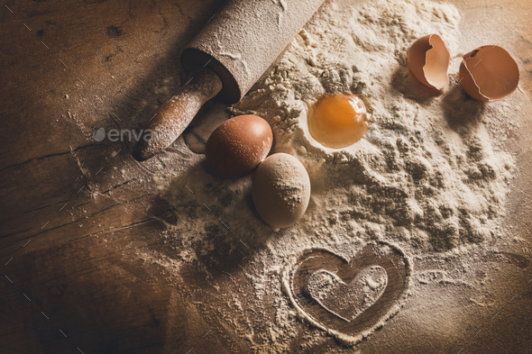 Rustic baking with symbol of heart in flour - Stock Photo - Images