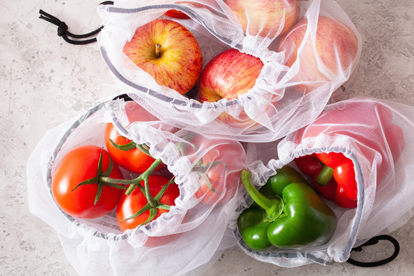 apples tomatoes bell peppers vegetables in reusable mesh nylon b - Stock Photo - Images