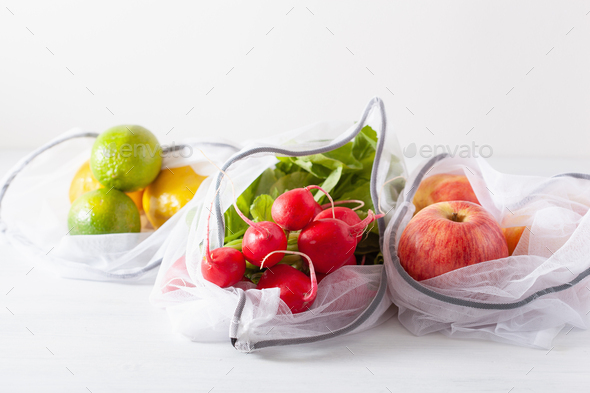 fruits and vegetables in reusable mesh nylon bag, plastic free z - Stock Photo - Images