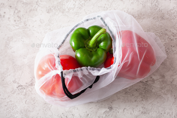 bell peppers in reusable mesh nylon bag, plastic free zero waste - Stock Photo - Images