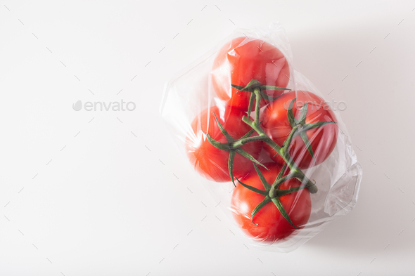 single use plastic packaging issue.tomatoes vegetables in plasti - Stock Photo - Images