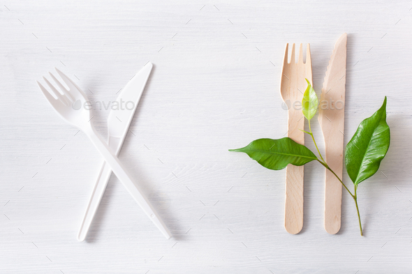 harmful plastic cutlery and eco friendly wooden cutlery. plastic - Stock Photo - Images