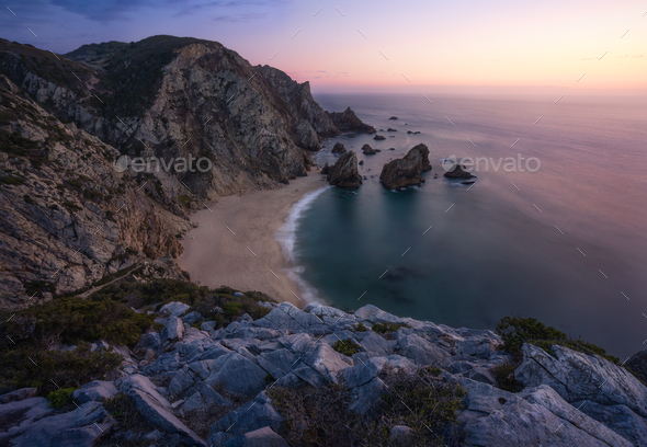 Sunset over a hidden surreal Praia Da Ursa Beach near Cabo Da Roca on Atlantic coast, Portugal - Stock Photo - Images
